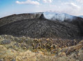 Smoking volcanic pinnacle close to erta ale volcano ethiopia in the area the lava flow formed incredible waves and patterns after Stock Image