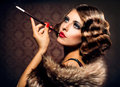 Smoking woman with mouthpiece retro portrait beautiful Royalty Free Stock Photo