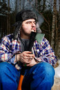 Smoking woodcutter with hatchet Stock Photo