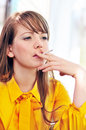 Smoking young woman Royalty Free Stock Photo