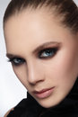 Smoky eyes close up portrait of beautiful stylish young woman with Royalty Free Stock Image