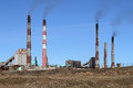 Smoldering pipe working plant pollute the atmosphere of the eart earth Stock Images