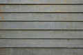 Smooth bare concrete wall with lines pattern Royalty Free Stock Photo