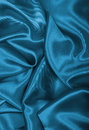 Smooth elegant blue silk or satin as background Royalty Free Stock Photo