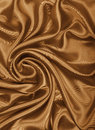 Smooth elegant golden silk or satin texture as abstract backgrou Royalty Free Stock Photo