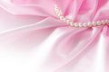 Smooth elegant rose silk background with pearl, Beautiful silk drapes Royalty Free Stock Photo