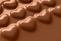 Smooth melted chocolate hearts photo of covered in creamy milk shot at an angle with copy space for your own message Royalty Free Stock Image