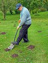 Smooth molehills senior country farmer by shovel Stock Photo
