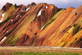 Smooth orange rhyolite mountains in landmannalaugar nature reserve in the hollows is last year s snow Royalty Free Stock Photo