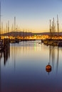 Smooth water in Geneva harbour at dusk Royalty Free Stock Photo