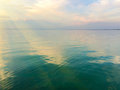 Smooth Water Surface And Sun R...