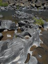 Smoothed lava rock in deschutes river in bend or Stock Photos