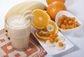Smoothie of banana, orange juice , frozen sea-buckthorn with y Royalty Free Stock Photo