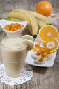 Smoothie of banana, orange juice , frozen sea-buckthorn   with y Royalty Free Stock Photo