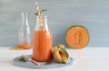 Smoothie with cantaloupe melon and white currants Royalty Free Stock Photo
