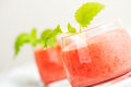 Smoothie drink with mint on table, in high key Royalty Free Stock Photo