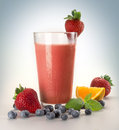 Smoothie fruit with glass and berries on grey Royalty Free Stock Photo