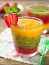 Smoothie glass of fresh peach kiwi and strawberry selective focus Royalty Free Stock Photos