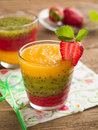 Smoothie glass of fresh peach kiwi and strawberry selective focus Royalty Free Stock Images