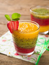 Smoothie glass of fresh peach kiwi and strawberry selective focus Royalty Free Stock Photography