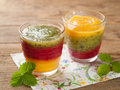 Smoothie glass of fresh peach kiwi and strawberry selective focus Royalty Free Stock Photo