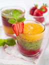 Smoothie glass of fresh peach kiwi and strawberry selective focus Stock Photography