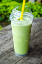 Smoothie in glass on table greentea Royalty Free Stock Photo