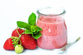 Smoothie or milkshake in glass jar with fresh strawberry fruits and mint isolated on white background Royalty Free Stock Photo