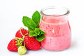 Smoothie or milkshake in glass jar with fresh strawberry fruits and mint isolated on white background healthy food for breakfast Royalty Free Stock Photography