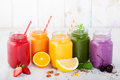 Smoothies juices beverages drinks variety with fresh fruits and berries on a white wooden background Royalty Free Stock Images
