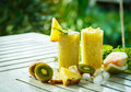 Smoothies of kiwi and pineapple on the table Royalty Free Stock Photo