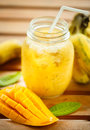Smoothies mango and banana in a glass jar Royalty Free Stock Photo
