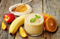 Smoothies with peaches, banana and orange Royalty Free Stock Photo