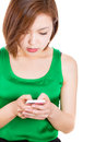Sms on cellphone beautiful woman reading a her mobile phone Royalty Free Stock Image