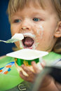 Smudgy baby boy eat in camp portait Royalty Free Stock Image