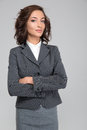 Smug young business woman with arms crossed Royalty Free Stock Photo