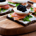 Snack with caviar and salmon Stock Image