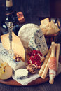 Snack cheese platter and fresh fruits toned photo Royalty Free Stock Photos