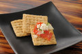 Snack crackers healthy whole wheat with tomato cucumber and feta cheese Stock Image