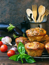 Snack savory muffins cakes with eggplant, tomatoes, basil and cheese on wooden background.