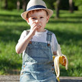 Snack time boy having a on a playground Royalty Free Stock Image