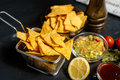 snack with tortilla corn chips, spicy salsa and delicious hot guacamole sauce Royalty Free Stock Photo