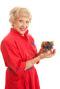 Snacking on healthy berries fit senior woman a bowl of mixed isolated white Stock Photos