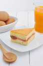 Snacks and eggs on white table Stock Images