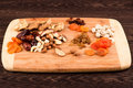Snacks of nuts and dried fruits on a wooden surface Royalty Free Stock Images