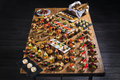 Snacks set. Brushettas, canapes, salads, desserts, tartlets, oysters on wooden table