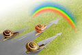 Snail crawling to the rainbow Stock Photo