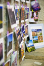Snaphots of moments printed pinned to the walls in a multitude of colors snapshots Stock Photos