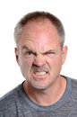 Snarl man making a face white background Royalty Free Stock Photos