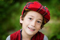 Snazzy scotish cap cute eight year old boy wearing a plaid Stock Image
